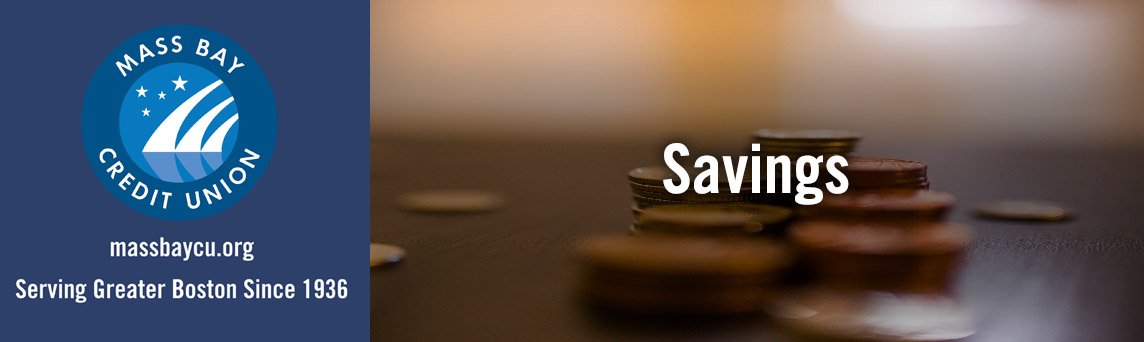 Save your money with Mass Bay Credit Union - stacks of coins on the table.